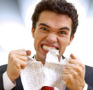 Annoying words and cliches - guy tearing paper with teeth