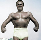 Charles Atlas flexing in his swimsuit