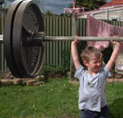 Child lifting heavy barbell