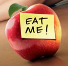 "Apple with Post-It note saying ""EAT ME!"""
