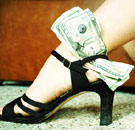Prostitute with dollar bills in high heels