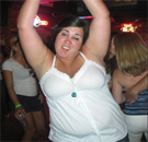 Fat chick dancing in the bar with her hands up