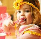 Young girl licks fork