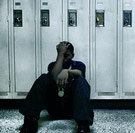 Guy looking lonely by high school lockers