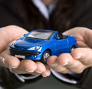 Man holding toy car in his hands