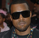 Kanye West with opaque black sunglasses on
