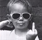 Kid with sunglasses on raising middle finger