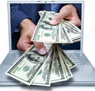 Laptop hands reaching out with hundred dollar bills