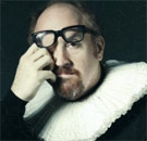 Louis CK rub his eyes in a Shakespeare outfit in disgust