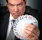Magician lawyer in a courtroom with a deck of cards