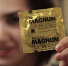 Girl holding up a Magnum Thin condom