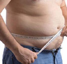 Guy measuring his belly fat