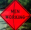 Men Working orange construction sign