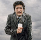 Newscaster standing in the rain