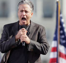 Jon Stewart yelling into a microphone at his Rally for Sanity