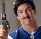 Peyton Manning holding a flip cell phone