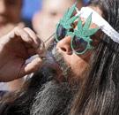 Man smoking pot with pot-framed sunglasses on