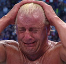 Rick Flair crying in the wrestling ring (WWE)