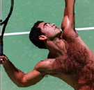 Hairy Pete Sampras serving tennis