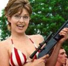 Sarah Palin holding a rifle in a bikini