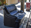 Leather sofa on the curb to be taken away as trash
