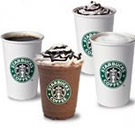 Four different Starbucks drinks in cups