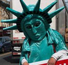Tax man in Statue of Liberty costume