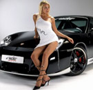 Hot girl sitting on a Porsche