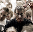 Guy surviving in the middle of a zombie attack