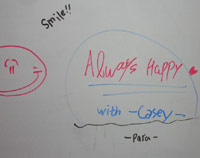 Whiteboard writing from KC's students - 'ALWAYS HAPPY WITH CASEY'