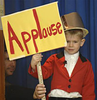 Kid holding an applause sign