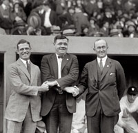 Babe Ruth and Ty Cobb pose for a picture on a baseball field