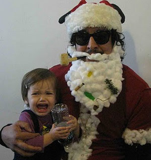 Bad scruffy Santa with a crying kid on his lap