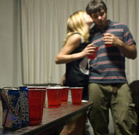 Flirting at beer pong table
