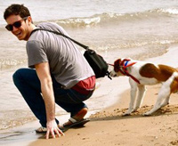 Bill Dixon on the beach with his dog