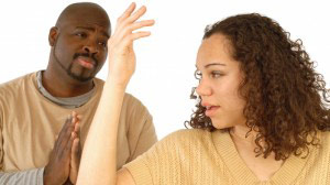 Black man pleading with his wife for forgiveness