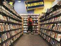 Woman renting DVD from Blockbuster.