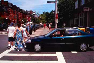 Car in pedestrian crosswalk