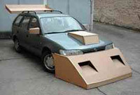 Shitty car with cardboard spoiler and fenders