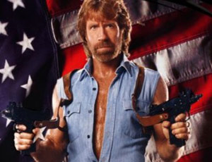 Chuck Norris holding two guns
