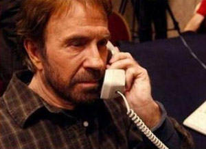 Chuck Norris looks old on the phone with Mike Huckabee