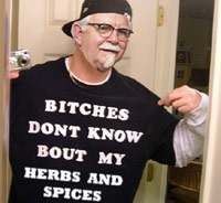 Colonel Sander with a tshirt on that says 'Bitches don't know bout my herbs and spices'