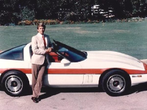 Smooth talking man next to his 1980 Corvette