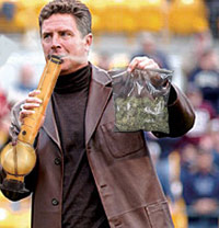 Dan Marino holding a bong and a bag of weed