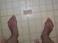 Dropped soap between feet in the prison shower