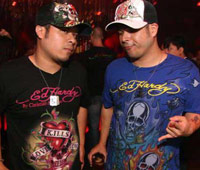 Two guys in Ed Hardy tshirts