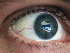 Human eye with Facebook logo reflection in it