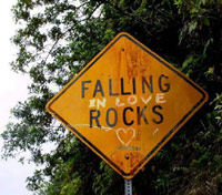 Falling in love rocks road sign