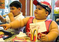 Fat boy eating at McDonald's
