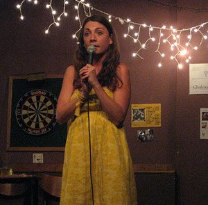 Female comedian doing open mic stand-up comedy night